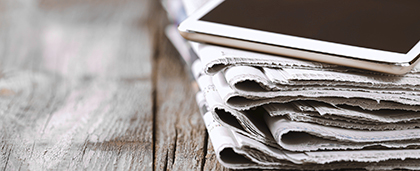 newspaper and digital tablet
